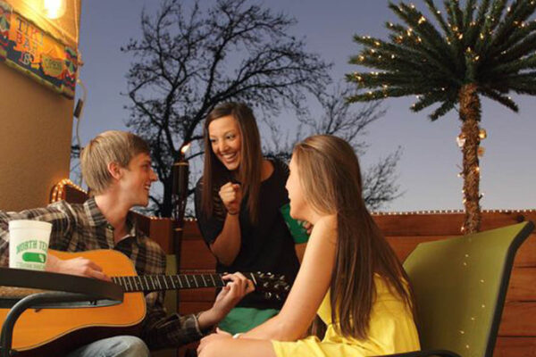 medium-students-enjoy-the-patio-at-apartments-in-denton
